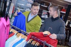 Men choosing sports wear in sport outlet Stock Photo