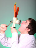 Men with chopper and carrot Royalty Free Stock Photo