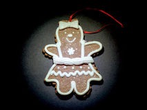 Men Christmas cookies illuminated by a flashlight on top on black Royalty Free Stock Photos