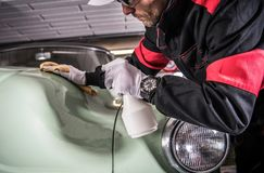 Men Cleaning His Car Body Stock Photo