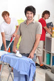 Men cleaning Royalty Free Stock Photos