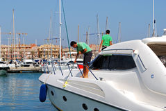 Men cleaning a yacht, Sotogrande. Men cleaning a yacht in the marina, Puerto Sotogrande, Cadiz Province, Andalucia, Spain, Western Europe Royalty Free Stock Photography