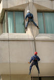 Men climbing. Men working, climbing a building Royalty Free Stock Photo