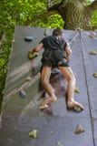 Men climbing on a wall Stock Image