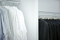 Men Closet. In the Men's Closet. Rows of Men's Apparel. Walk-In Closet Royalty Free Stock Photography