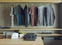 Men cloths in wooden walk in closet stock photo
