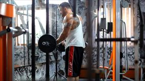 The men in club up the heavy equipment for bodybuilding and he have strong hands. stock footage
