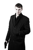 Men in coat with a gun Stock Photography