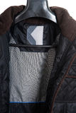 Men coat isolated on the white background Stock Photography