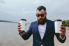Men and coffee on the beach Stock Images