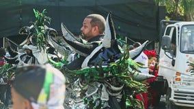 Men in colorful carnival costumes prepare for traditional dominican annual event