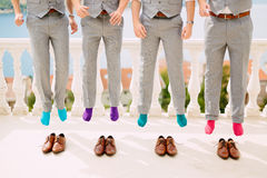 Men in colorful socks. Funny wedding photos. Wedding in Monteneg stock photos