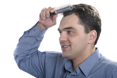 Men with comb Stock Photography