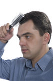 Men with comb close up Stock Images
