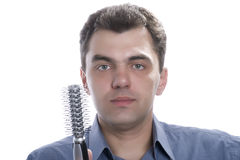Men with comb on white Royalty Free Stock Image