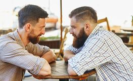 Men communicate with their views at the table. Two men communicate with their views at the table stock photography