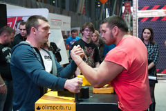 Men compete in armwrestling Royalty Free Stock Image