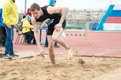 Men compete in long jump, Orenburg, Russia Royalty Free Stock Photos
