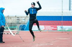 Men compete in long jump, Orenburg, Russia Royalty Free Stock Photo