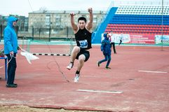 Men compete in long jump, Orenburg, Russia Stock Photos