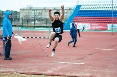 Men compete in long jump, Orenburg, Russia Stock Photos