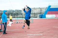 Men compete in long jump, Orenburg, Russia Stock Images