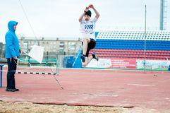Men compete in long jump, Orenburg, Russia Stock Image