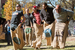 Men Compete In Old Fashioned Sack Race At Atlanta Festival Stock Image