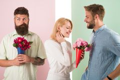 Men competitors with bouquets flowers try conquer girl. Broken heart concept. Girl smiling made her choice. Girl popular. Receive lot male attention. Woman royalty free stock photos