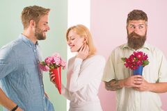 Men competitors with bouquets flowers try conquer girl. Broken heart concept. Girl smiling made her choice. Girl popular royalty free stock photos