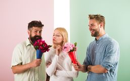 Men competitors with bouquets flowers try conquer girl. Girl likes to be in middle attention. Girl popular receive lot. Men attention. Love triangle. Woman stock photography