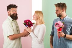 Men competitors with bouquets flowers try conquer girl. Girl smiling made her choice. Broken heart concept. Girl popular. Receive lot male attention. Woman royalty free stock image