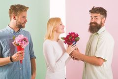 Men competitors with bouquets flowers try conquer girl. Girl smiling made her choice. Broken heart concept. Girl popular. Receive lot male attention. Woman stock images