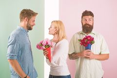 Men competitors with bouquets flowers try conquer girl. Girl smiling made her choice. Girl popular receive lot male. Attention. Woman happy takes bouquet stock image