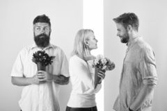 Men competitors with bouquets flowers try conquer girl. Girl smiling made her choice. Girl popular receive lot male. Attention. Woman happy takes bouquet stock photo