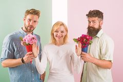 Men competitors with bouquets flowers try conquer girl. Girl smiling reject gifts. Out of relations. Girl popular. Receive lot men attention. Feminism concept stock images