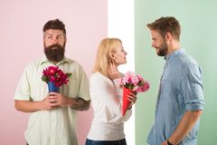 Men competitors with bouquets flowers try conquer girl. Girl smiling made her choice. Girl popular receive lot male. Attention. Woman happy takes bouquet royalty free stock images