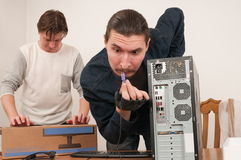 Men and the computer. Stock Photography