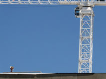 Men at construction site. And crane at the side Stock Photography