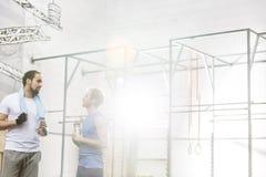 Men conversing in crossfit gym Stock Photo