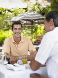 Men Conversing At Outdoor Caf� Stock Photo