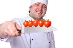 Men cook. cherry tomatoes cut into the knife Stock Photo