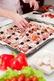 Men cooking fresh italian pizza close up Stock Image