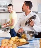 Men cooking potato soup Stock Photography