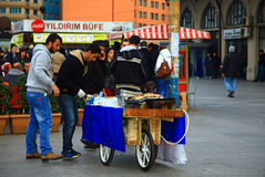 Men cooking and selling a street food in Istanbul. Royalty Free Stock Image