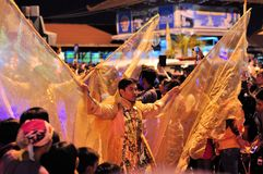 Men are costumed like angels, Yogyakarta city. Yogyakarta, Indonesia - 7 October 2014:  258th city anniversary - Men are dressed up like angels with wings while Stock Photos