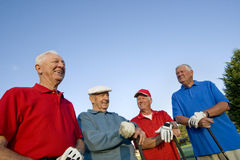 Men on Course with Clubs Stock Image