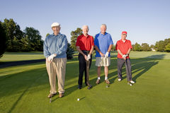 Men on Course with Clubs Royalty Free Stock Photo