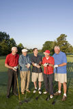 Men on Course with Clubs Royalty Free Stock Image