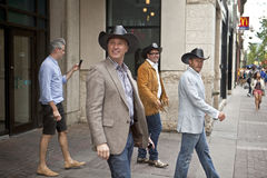 Men in cowboy hats & boots. Calgary Royalty Free Stock Photo